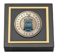 Black marble paperweight features a custom-minted medallion of your school seal. Paperweight comes beautifully boxed for gift giving. Search for your school or organization today!
