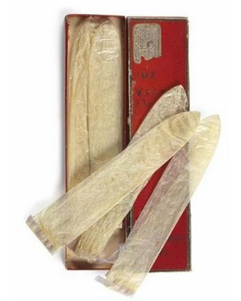 110-year old reusable condoms made from fish bladder. At that time were reusable to an estimated amount of 10 times. Along with the original cardboard box with the maker's label. The box's size was a 26 x 6 cm. The fish bladder condoms with its case sold for a whopping 2000 Euros at auction. There are signs of crosses on the packaging that may indicate how many times the condoms were used before by the owner. And if you look closely you can even find the manufacturer.