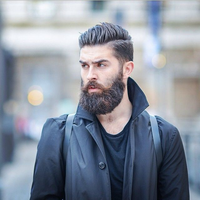 Chris John Millington - full thick dark beard.