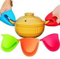 Features: 1.The silicone mini pot holders keep your hands safe from burning when    serving, baking,