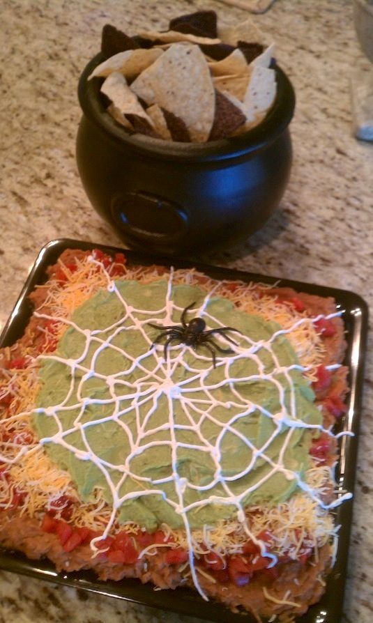 Spiderweb Nacho Spread The BEST Halloween party dip! Who doesn't love a bunch of yummy layers topped with a sour cream spider web?? Serve th...