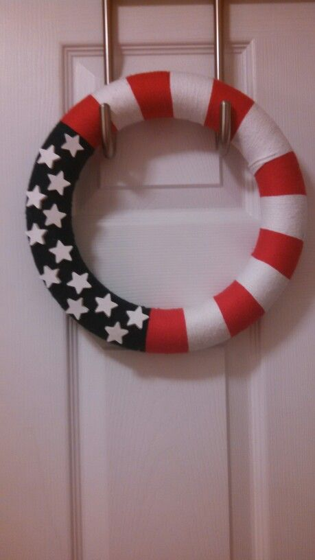 Red white a blue yarn wreath with wooden stars