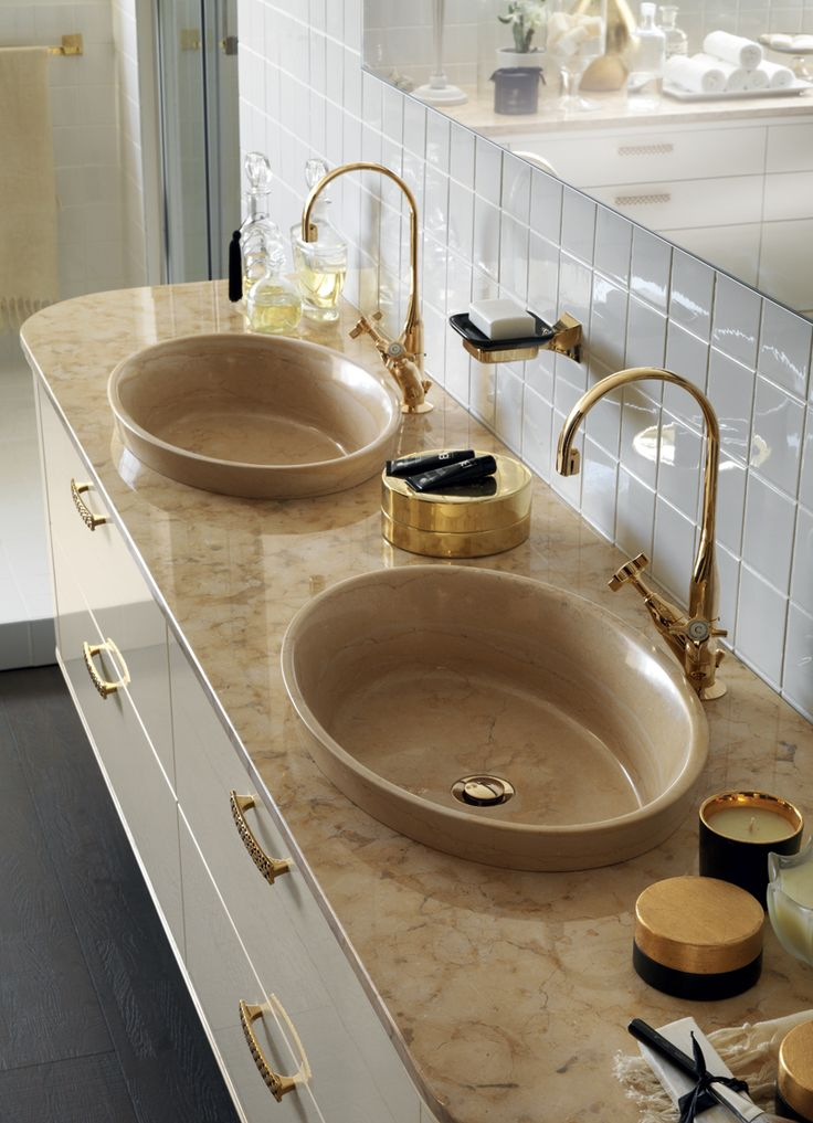 Gold details and a top with oval washbasins in Jerusalem Gold stone, is the main star of this refined #bathroom