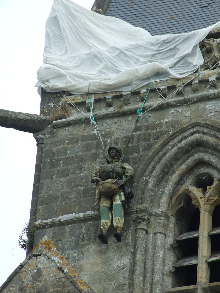 Private John Steele survived his ill-fated landing on the church at Ste. Mere Eglise in Normandy with a bullet wound to his foot and temporary deafness.