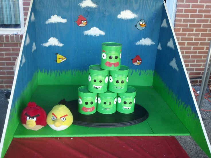 Angry Birds can toss - paint the tin cans for this game. add the backdrop to catch the cans. cut out angry bird pictures (use spray modge podge to have them stick to the wood board).