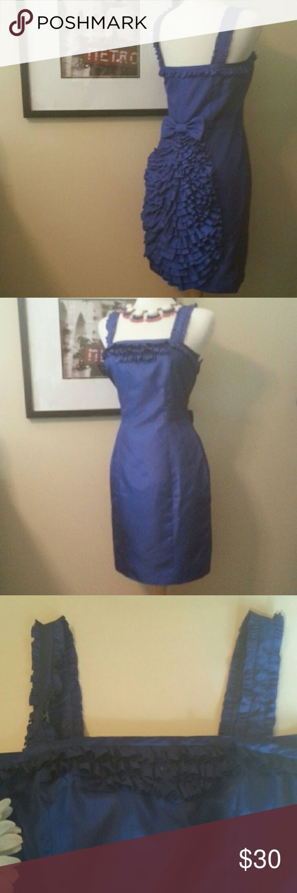 """BeTsey Johnson Party Bustle Dress The most gorgeous royal blue I have come across!  This dress look, feels & sounds like taffata but is poly.  Fully lined in same color with a satin feel lining.  Side zipper, bow at back waist with a cascading ruffled bustle that goes to hemline hiding a convenient kick pleat.  Great special occasion, party or  prom dress.  Waist is 15.25"""" Armpit to hemline is 30"""" Betsey Johnson Dresses"""