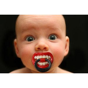 So, is it me...or does this babe know how he looks? Look at his eyes....funny kid! Vampire Pacifier $4.99