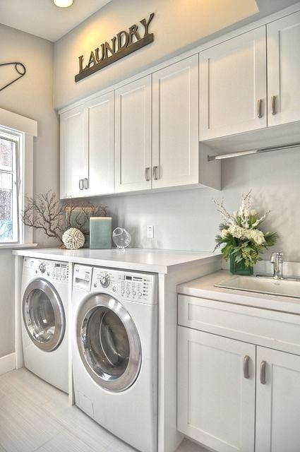 Not a fan of your laundry room design? Here are a few quick tips to transform the space from feeling commercial to an inviting space in your home. Adding cabinets and a folding table will create structure and help with organization. For lighting, ambient lighting, such as recessed lights, provides an area with overall illumination, which is ideal for this type of space. Lastly, to give your laundry space life and personality, consider a touch of paint and some accent decor.