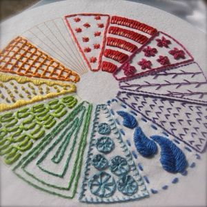 This color wheel project teaches embroidery - so cool!  Oh please let my little girl want to sew!!!