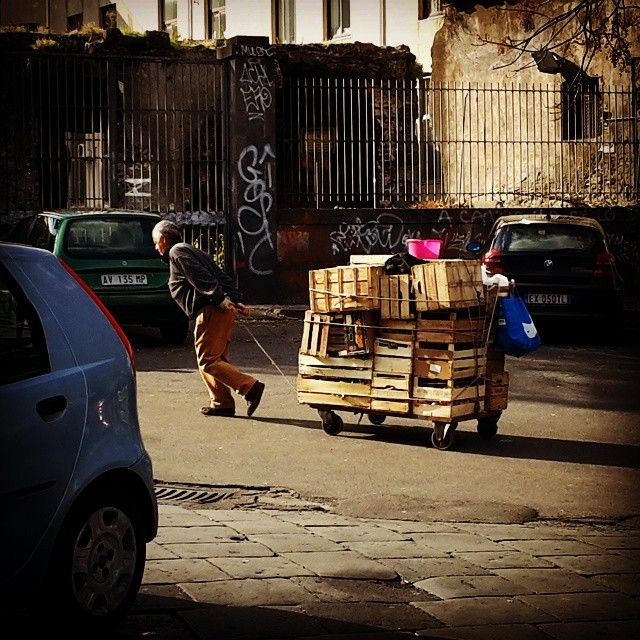 Every day we see this old man carrying his cart full of vegetables through Piazza Currò, to sell them at the nearby fish market.