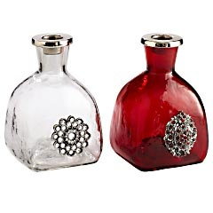 Occasionally I have an empty Patron bottle. They are shaped just like these. Never knew what to do with them. Bling...duh. Vases or candle holders.
