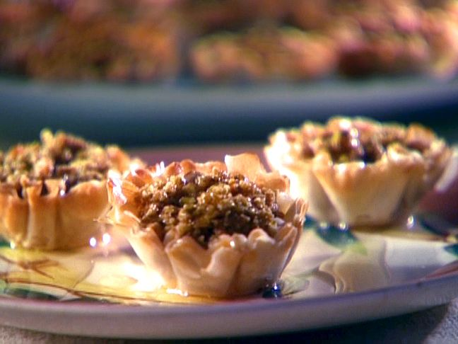 Baklava Cups from FoodNetwork.com- going to try it tonight with maybe a little less sweet stuff. Plus, I only have huckleberry honey from Hannibal! Still, it's Turkish night on California Ave!