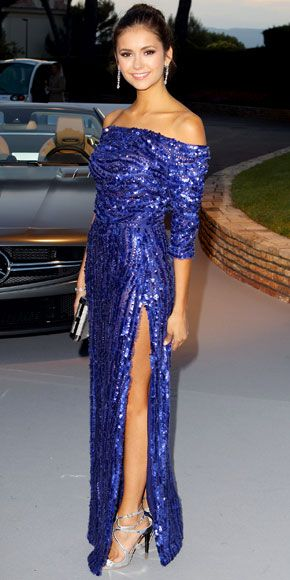 05/25/12: NinaDobrev flaunted her flawless tan in a shimmering, high-slit design. lookoftheday