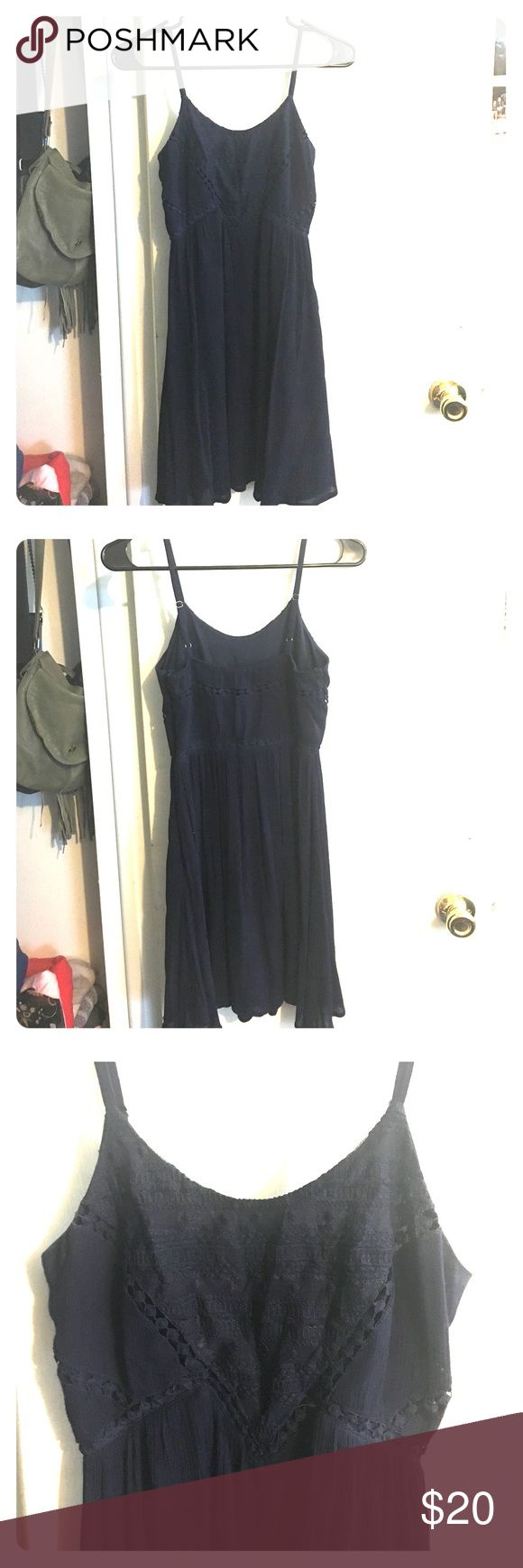 Navy blue dress More formal than a sundress but less formal than a cocktail dress. Wore it for sorority recruitment as an example. Has embroidery in the front and is double layered. Worn one time. Lulu's Dresses