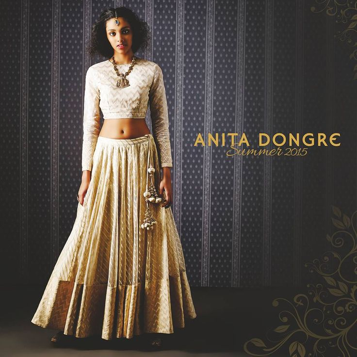 Traditional yet unconventional. For a night devoted to fun, frolic and dance- the Marala crop top and lehenga in shades of gold is a simple ensemble for a sangeet or mehendi.
