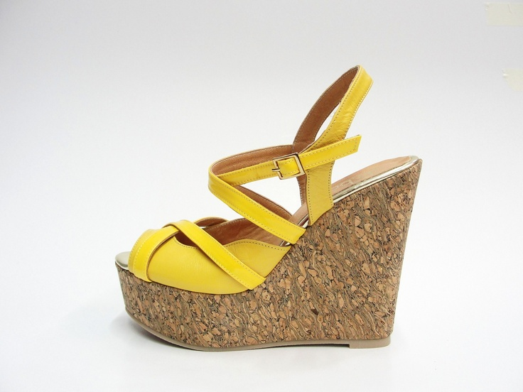 leather & patented leather upper.  cork wedge.  gold trimming inner sole.