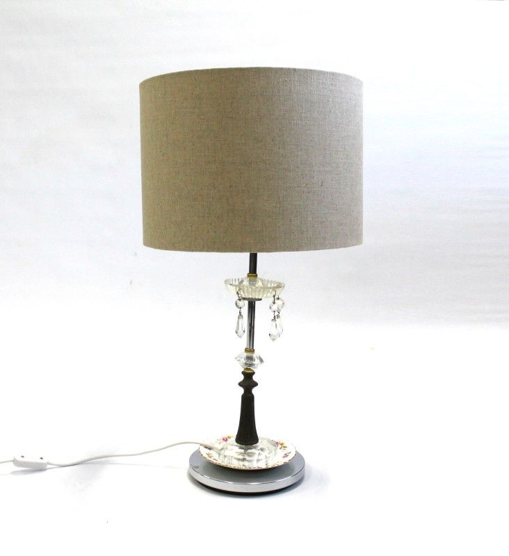 Beautiful lamp made from vintage candelabras, crockery and chandeliers.
