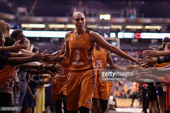 Diana Taurasi of the Phoenix Mercury high fives fans as she walks off the court following the first half of the WNBA game against the San Antonio Stars at Talking Stick Resort Arena on July 30, 2017...