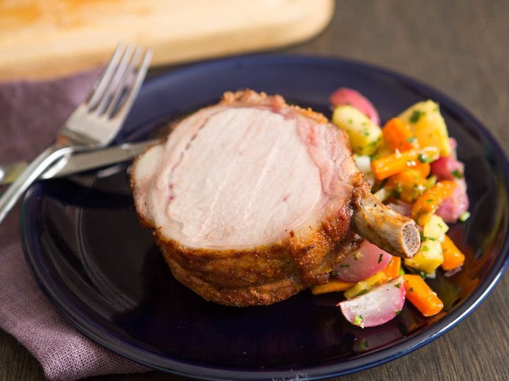 A bone-in pork loin roast is one of those cuts that's guaranteed to impress. The best part is that it's also dead easy to cook just right, as long as you use the reverse-sear method: Cook it low and slow until it's perfectly done throughout, then crank the heat to brown the exterior.