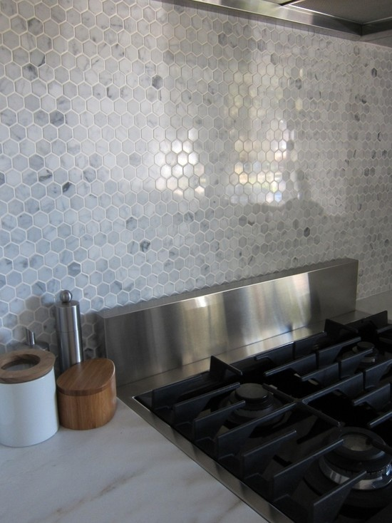 Hexagon marble backsplash.. I can't wait till we get to move in and put this up!