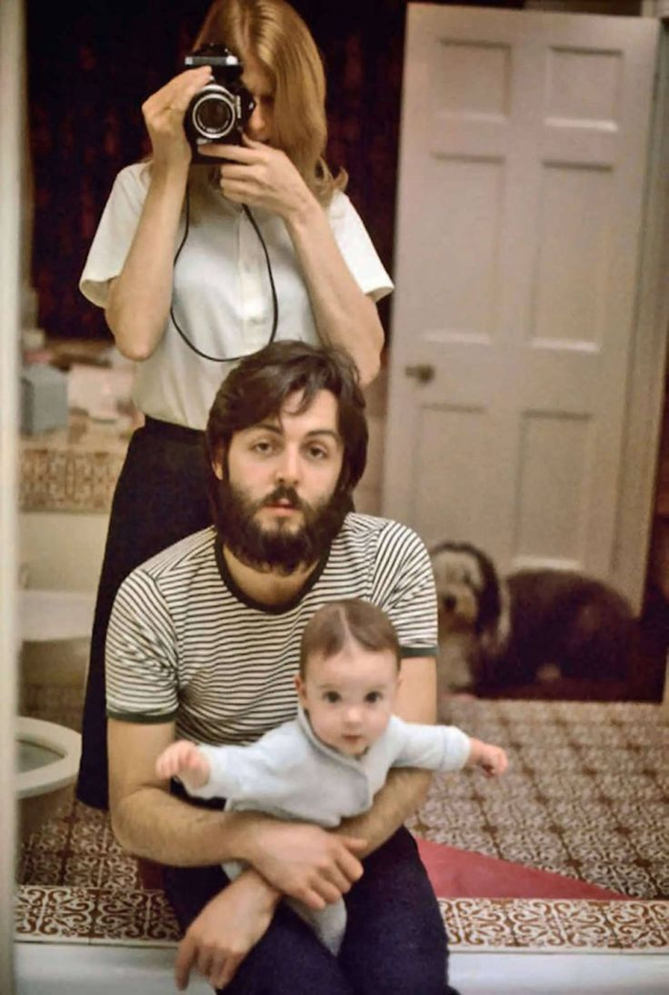 Linda McCartney takes a mirror selfie with husband Paul and daughter Mary; London, 1969.