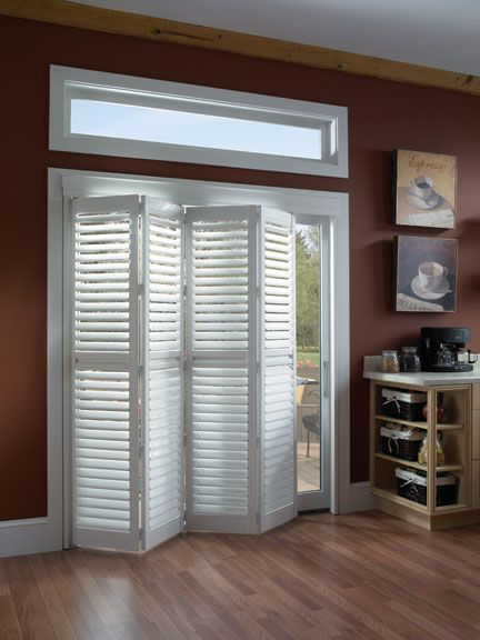 Cover those unsightly sliding glass doors with shutter style doors. Brilliant! Need this for the basement!