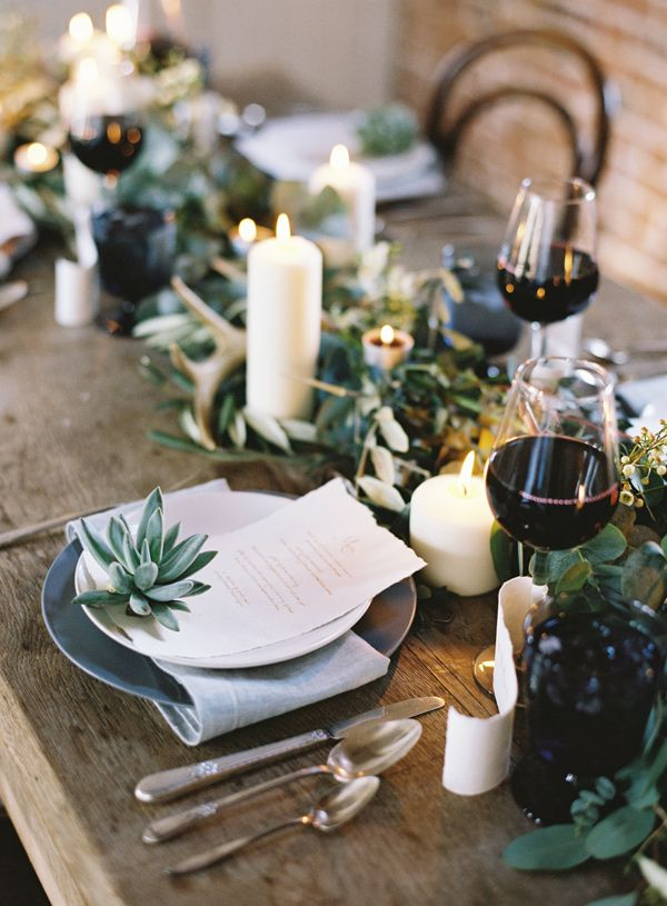 Minimalist tablescape with a garland and succulents