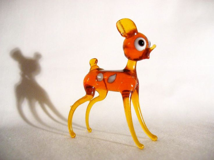 Hand blown glass animals. Wow, my Nan has this exact deer.....the house feels so cool and retro!