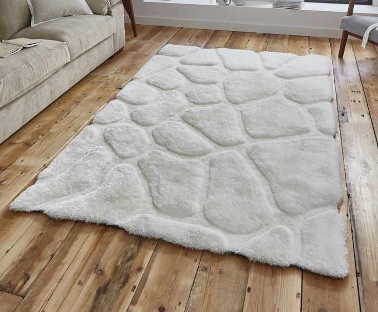 Hand tufted acrylic and soft polyester   Cotton canvas backing / bound   Non shedding / slight sheen   Creamstriking pebble design   Two sizes available   Free express delivery   Product code: NHC58