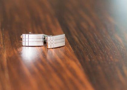 Cufflinks on wooden table
