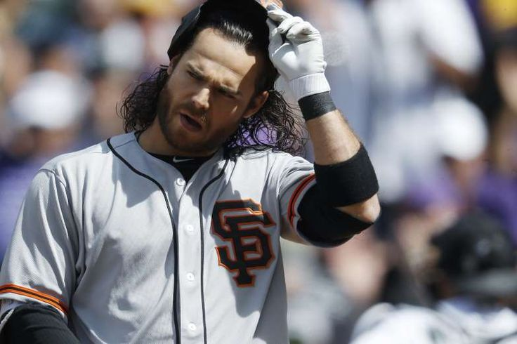 Giants-Dodgers tickets plunge to $6 after brutal start  -  April 24, 2017 San Francisco Giants' Brandon Crawford reacts after striking out against Colorado Rockies starting pitcher Kyle Freeland to end the top of the sixth inning of a baseball game Sunday, April 23, 2017, in Denver. Colorado won 8-0. (AP Photo/David Zalubowski)