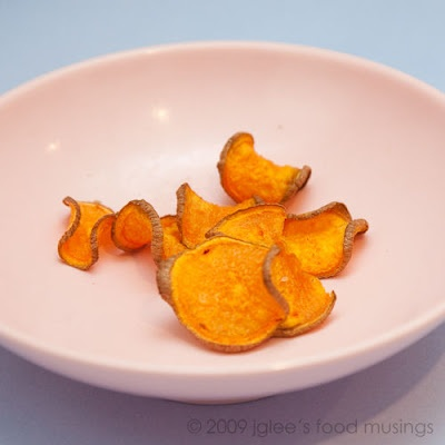 Baked sweet potato chips? I tried slicing the potatoes thinly, but they weren't thin enough to get crispy. I MUST get a mandolin slicer.