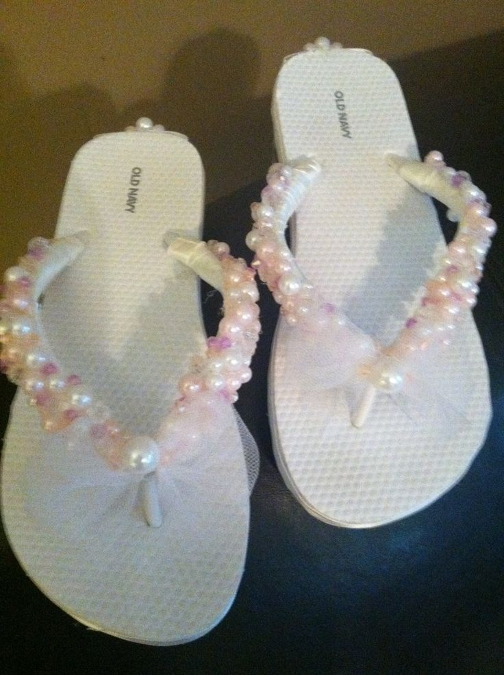 Bridal Shoes for Sarah! Regular flip flops plus princess beads from wal-mart for 3.97. And tulle and white ribbon. For around 5 bucks, I blinged these out.