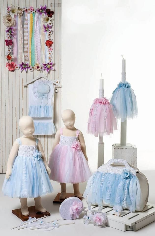 """Fluffy dress of light blue or pink muslin with cotton lace bodice and handmade flower. Combined with tough leather bag """"dressed"""" with cotton lace and a matching decoration. Matching rich candle wax with lace and handmade flowers. Matching witness box and ladoset. Cloths cotton."""