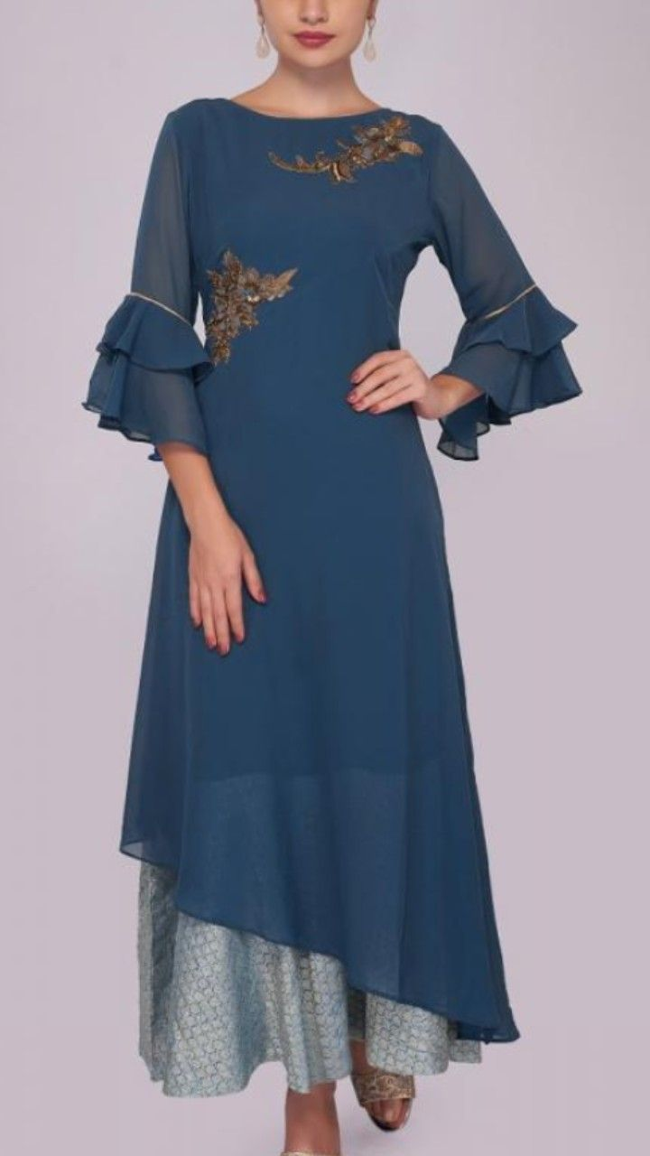 63b4705516bc5 Beautiful Georgette asymmetric Kurti . Embellished with hand embroidery  butas placement and bell sleeves with gota patti. Paired with doted silk  gharara.
