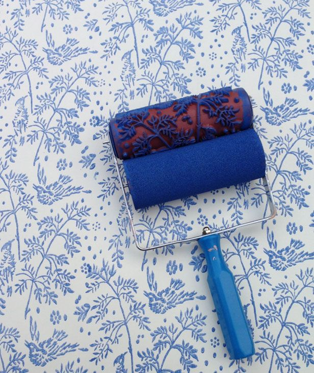 Make your own faux wallpaper with a patterned paint roller. SO cool!