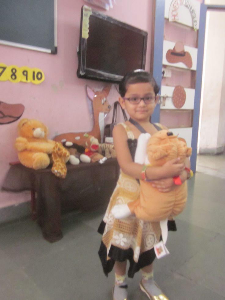 nursery child showing brown  colour day concept . #child #perform #theme #celebration