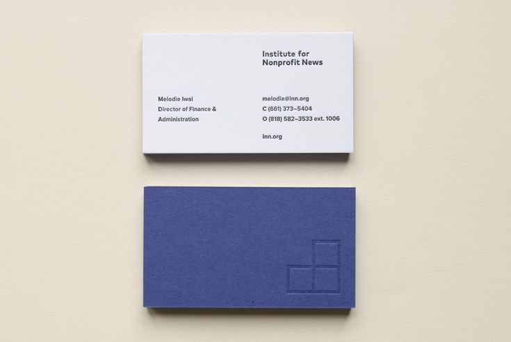 INN coloured board and blind embossed business cards by Studio Anthony Lane.