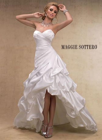 Maggie Sottero Bridal Gown. A stunning high-low hemline for the fashion forward bride ready to transition from ceremony to celebration, this L'Amour Satin strapless A-line features a sweetheart neckline, ruched bodice, and romantic pick-up skirt. Finished with corset back closure. - Avery-14013