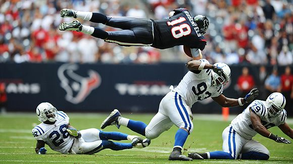 Sunday was a good day for Texans QB Sage Rosenfels -- until this play against the Colts. Rosenfels fumbled after being hit by Marlin Jackson (28); Indy's Gary Brackett (not pictured) picked up the loose ball and ran 68 yards for a TD. It was a pivotal play in the Colts' 31-27 comeback win