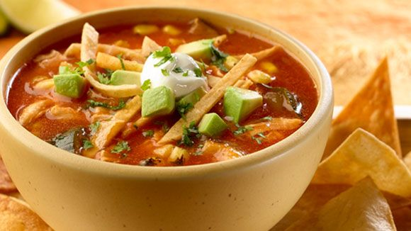 For an easy version of an authentic Mexican recipe, try this Chicken & Vegetable Tortilla Soup for a creamy and simple soup for dinner. Boil water and add chilies. Cool and chop chilies. Cook garlic, tomatoes, onion, chilies and oregano for 5 minutes. Stir in 6 cups water and Knorr® Tomato Bouillon with Chicken flavor. Bring to a boil then reduce heat and simmer. Process mixture until smooth and return to saucepot. Stir in chicken, corn and zucchini and boil.  Add tortilla strips and serve!