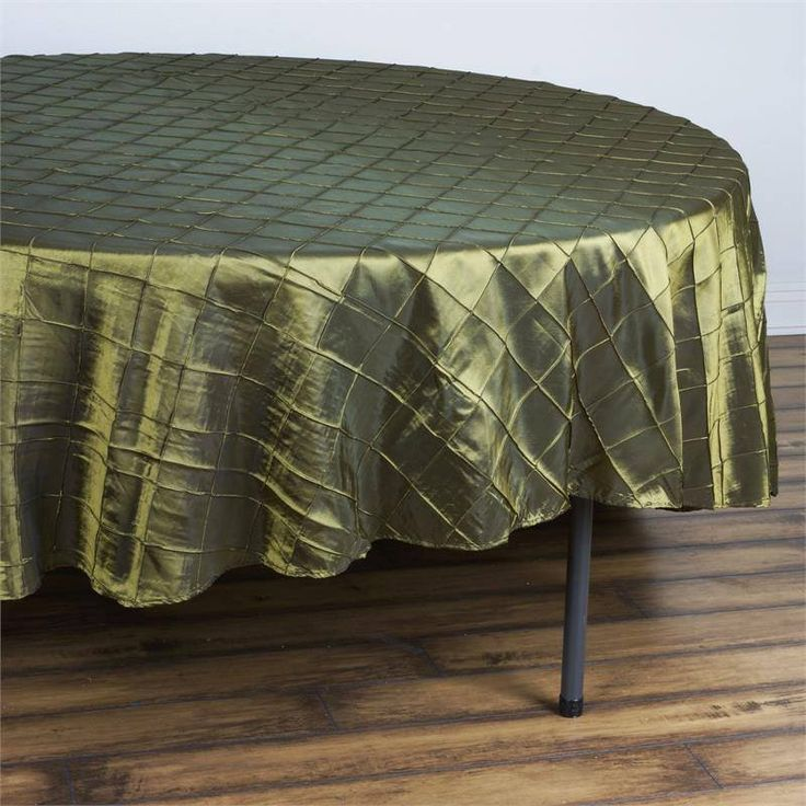 """Pintuck Tablecloths 90"""" Round - Moss / Willow - Pintuck is actually a fold of fabric that is stitched intricately to hold it in a place, very much like a pleat. These lovely pleats impart a decorative effect to the fabric by fashioning a visual line at a chosen point. They effortlessly bridge vintage and contemporary styles to create a majestic new classic look. If you do not want your celebration to blend in with other weddings, birthdays, and anniversaries, try our premium quality pintuck…"""