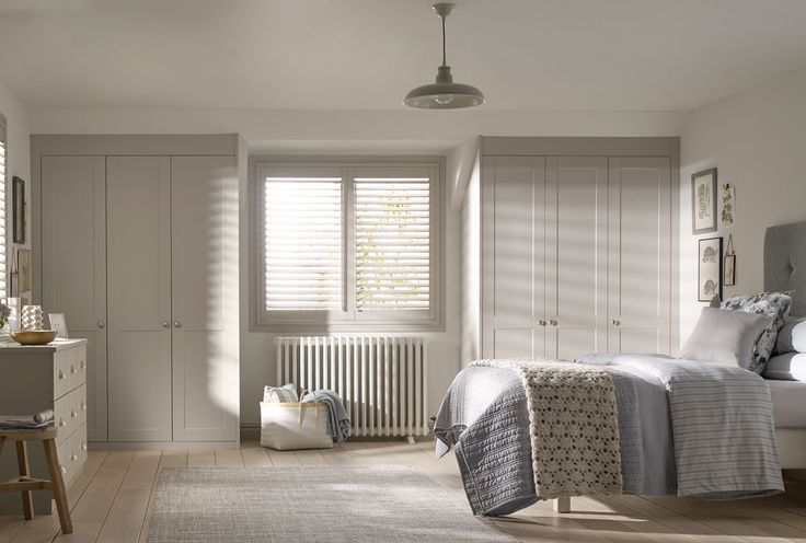 Soft grey Henley Shaker style wardrobes with cosy country decor.