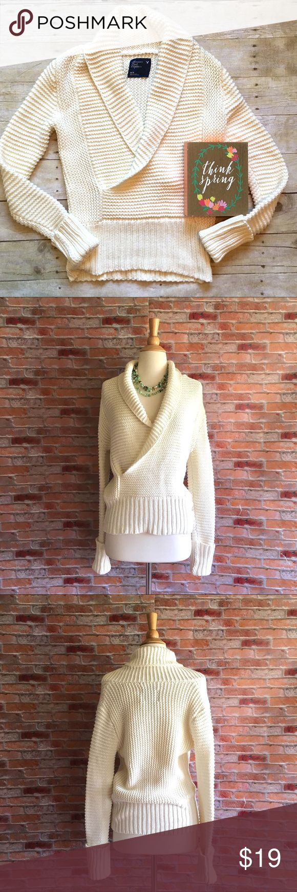 """American Eagle Ivory shawl collar sweater Lovely thick knit ivory sweater featuring a shawl collar and ribbed cuffs and hem. In excellent condition. 25""""L. 63/27 cotton, arcylic. Size medium. American Eagle Outfitters Sweaters"""