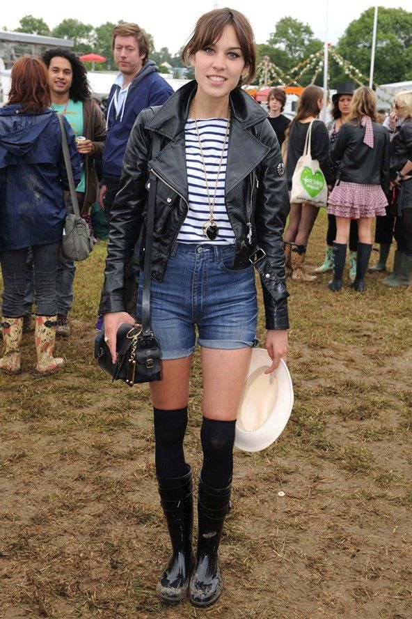 Alexa Chung wearing a biker jacket, Breton T-shirt, denim shorts and over-the-knee socks with wellies, she put her own spin on festival fashion at Glastonbury.