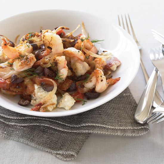 Shrimp Saganaki | For shrimp saganaki, Greeks sauté shrimp in a pan with tomatoes, olives and feta cheese, then serve it right out of the skillet with bread to soak up all the delicious juices. Grace Parisi stirs fresh dill into her quick version to brighten the flavor.