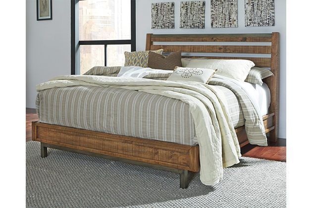 Beauty in the raw. Inspired by urban industrial design, the Dondie California king bed is a mastery in minimalism. The open-slat aesthetic is clean and linear. The feel? Substantial. Crafted with solid pine wood that's heavily distressed for a reclaimed lumber look, it's topped off with a touch of aged bronze-tone metal for weathered character with a modern edge. Mattress and foundation/box spring available, sold separately.