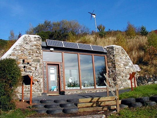 ". Earthship n. 1. passive solar home made of natural and recycled materials 2. thermal mass construction for temperature stabilization. 3. renewable energy & integrated water systems make the Earthship an off-grid home with little to no utility bills.    Google ""Garbage Warrior"" for more information"