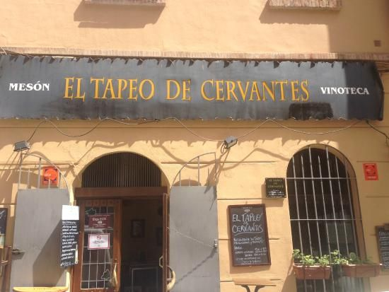 Restaurant Tapeo de Cervantes in Malaga. Small, cosy, bustling and right in the centre. A bunch of chalkboards hang inside, scribbled with the most varied dishes, menus and tasty tapas. Comfortable atmosphere, fun service and excellent quality. The restaurant is hugely popular with tourists, but also with the Malagueños themselves and it is practically always busy. The 'terrace' located right on the street only has room for two tables! www.travelguidemalaga.com