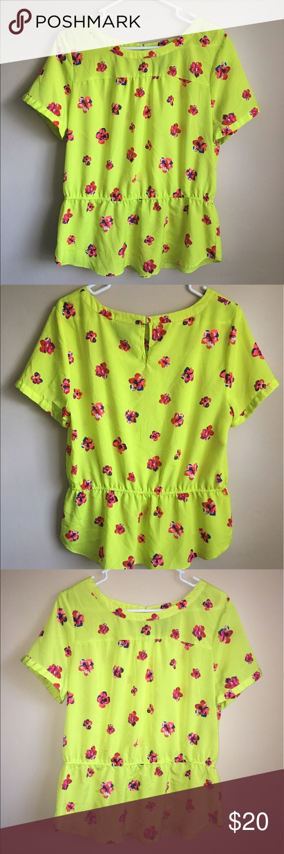Floral neon yellow with flowers blouse Beautiful neon yellow top with flowers in front and back. In good condition. Size Large. 100% Polyester. Perfect for the summer ! attention Tops Blouses